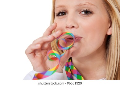 Attractive teenage girl having fun with colorful paper streamer. All on white background.
