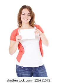 Attractive teenage girl holding blank white placeholder. All on white background.