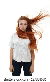 Attractive teenage girl model with hair blowing in the wind