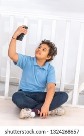 attractive teenager boy holding his smartphone with his hand and taking a selfie of himself