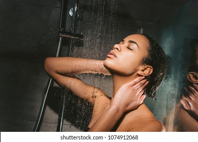attractive tender african american girl taking shower