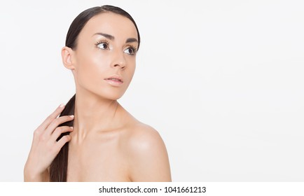 Attractive tender beautiful young woman with clean and fresh skin and healthy hair. Spa treatments. Cosmetology. Skin care. Strong hair and healthy body