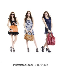 Attractive three young woman with bag standing on a white background