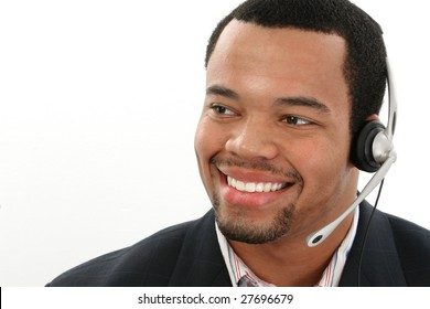 Attractive twenties African American man over white background.  Customer service representative.