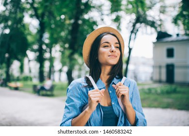 Attractive Ukrainian female tourist enjoying breathtaking journey trip for exploring world, beautiful hipster girl feeling happiness and relaxation during free time in city nature environment