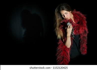attractive vocalist in red boa