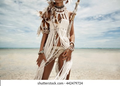 Attractive wild boho woman at beach