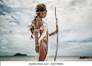 Attractive wild boho woman at beach