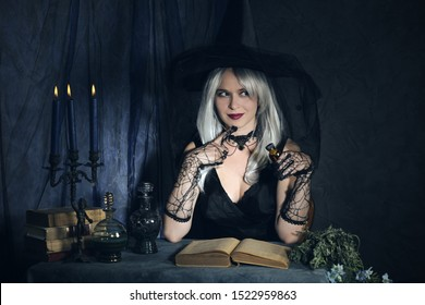attractive witch casts a spell