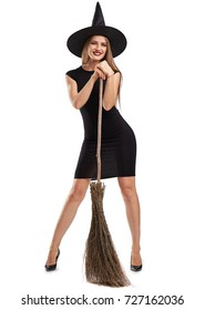 Attractive witch girl with a broom isolated on a white background. Halloween costumes concept.