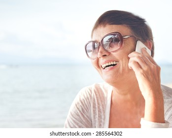 attractive woman of 50 years with a mobile phone