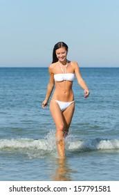 Attractive woman bathes at the sea