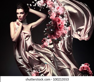 attractive woman in beautiful fabric and flowers