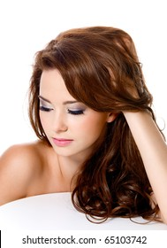 attractive woman with beautiful hairs and fashion makeup - isolated