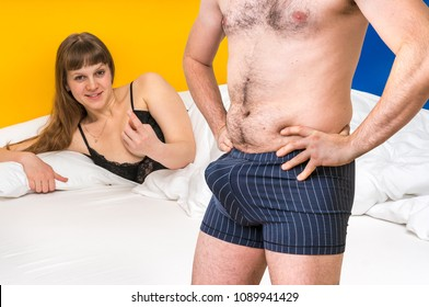 Attractive woman in bed and man in underwear with big penis inside