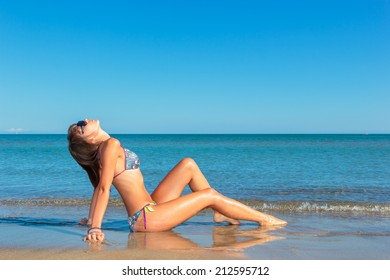 attractive woman in bikini, outdoor on the beach