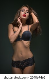 attractive woman in black lingerie at dark