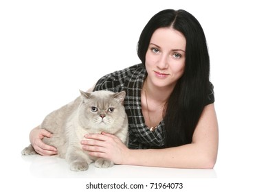 Attractive woman with a British cat on a white background