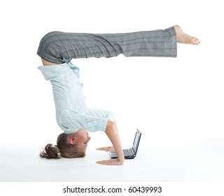 Attractive woman browsing on laptop in unusual yoga pose heels over head