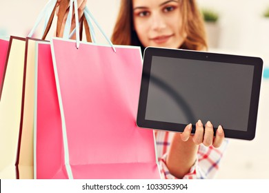 Attractive woman buying Easter gifts online