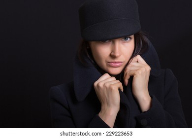 the attractive woman in a cap on a white background