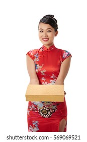 Attractive woman in Chinese traditional dress giving you present
