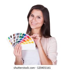 Attractive woman chooses a color scheme. Studio portrait over white