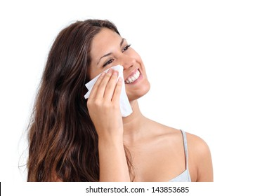 Attractive woman cleaning her face with a face wipe isolated on a white background