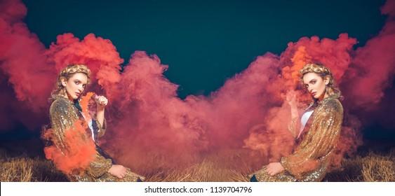 Attractive woman with a colourful smoke cloud grenade bomb fashion glitter