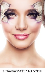 attractive woman with creative make-up on white background