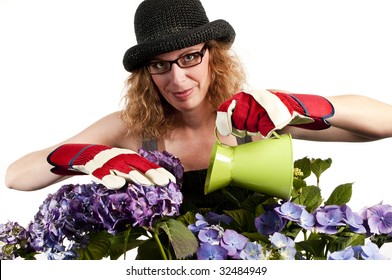 Attractive woman does gardening with watering can on white background