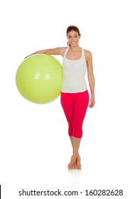 Attractive woman doing exercise with a big green ball isolated