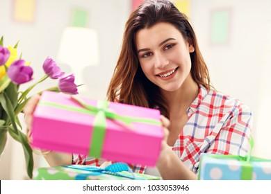Attractive woman with Easter presents