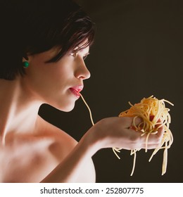 attractive woman with eating spaghetti. Concept idea
