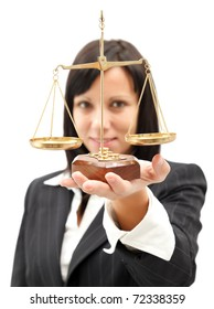 Attractive woman in elegant suit holding scales of balance