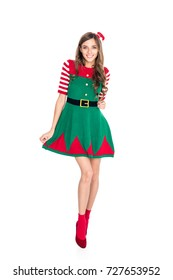 attractive woman in elf costume posing isolated on white