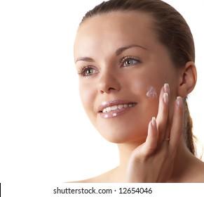 attractive woman enclosing cream smiles