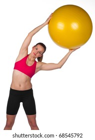 attractive woman exercise with big pilates ball