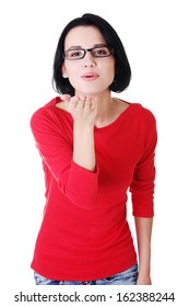 Attractive woman in eyeglasses sending kiss.Isolated on white.