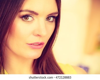 Attractive woman face. Portrait of young long hair female, toned image