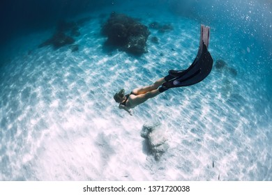 Attractive woman freediver with fins. Freediving underwater in Hawaii