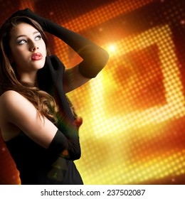 attractive woman in front of light background