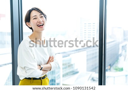 Attractive woman in front of window.