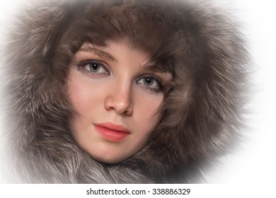 attractive woman in fur hood on white background
