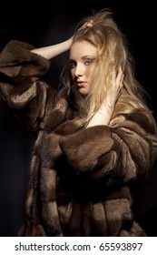 Attractive woman in fur sheepskin jacket