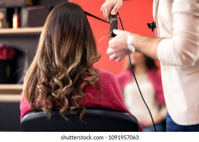 Attractive woman getting her hair done in the beauty salon