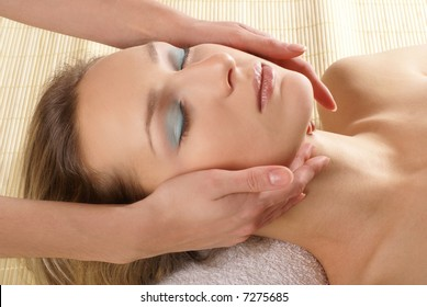 Attractive woman getting neck massage and spa treatment
