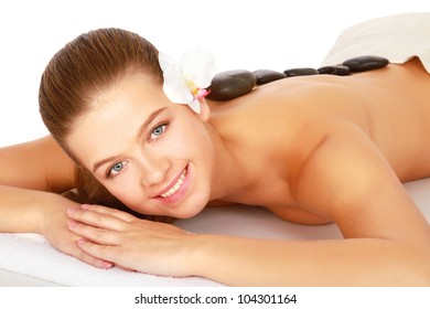 An attractive woman getting spa treatment, isolated on white background
