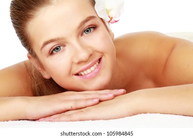 Attractive woman getting spa treatment isolated on white background