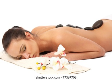 An attractive woman getting spa treatment isolated on white